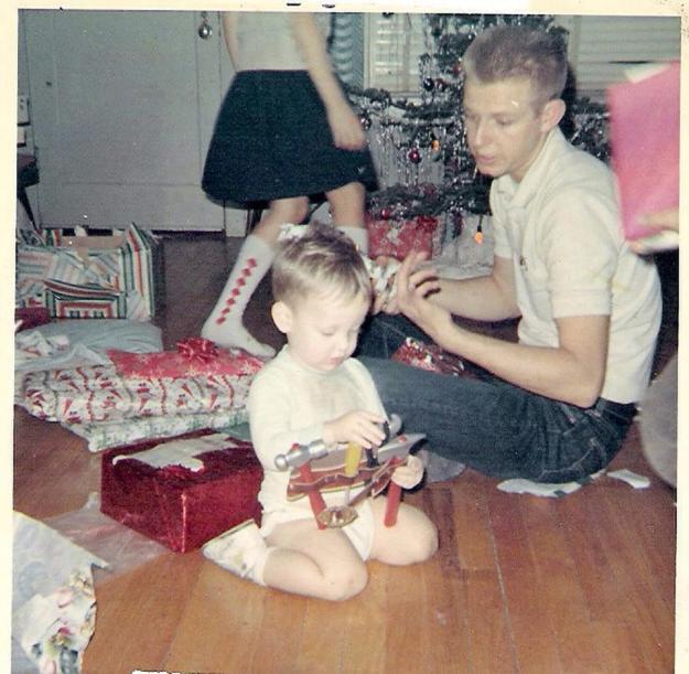 Here's my dad at some Christmas, with some child.